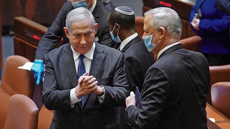 After more than 500 days without a stable government and three inconclusive elections, lawmakers approved a Netanyahu-Gantz coalition [Adina Valman/Knesset via AFP]