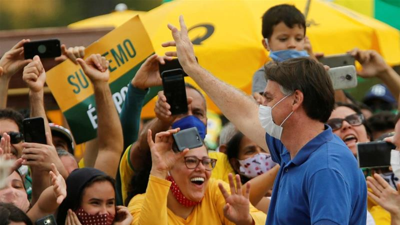 President Bolsonaro has compared the virus with a 'little flu' and condemned the 'hysteria' surrounding it [Adriano Machado/Reuters]