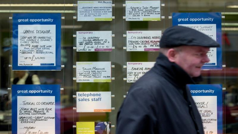 Demand in the United Kingdom's retail, catering and hotel sectors has tanked and the country's jobless rate has continued to rise in May [File: Neil Hall/Reuters]
