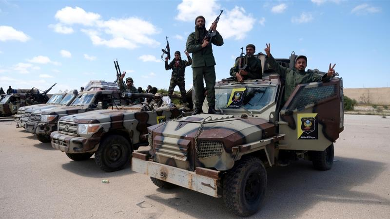 In this file photo from April 2019, LNA members pose for a picture as they head out of Benghazi to reinforce the troops advancing on Tripoli [File: Esam Omran Al-Fetori/Reuters]