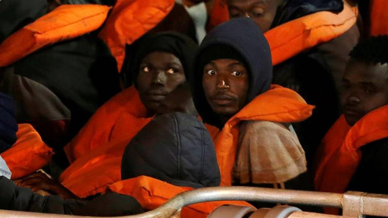 Rescued migrants look on from a military vessel after it arrived in Valletta's Grand Harbour in Malta on April 10, 2020 [File photo/Darrin Zammit Lupi/Reuters]