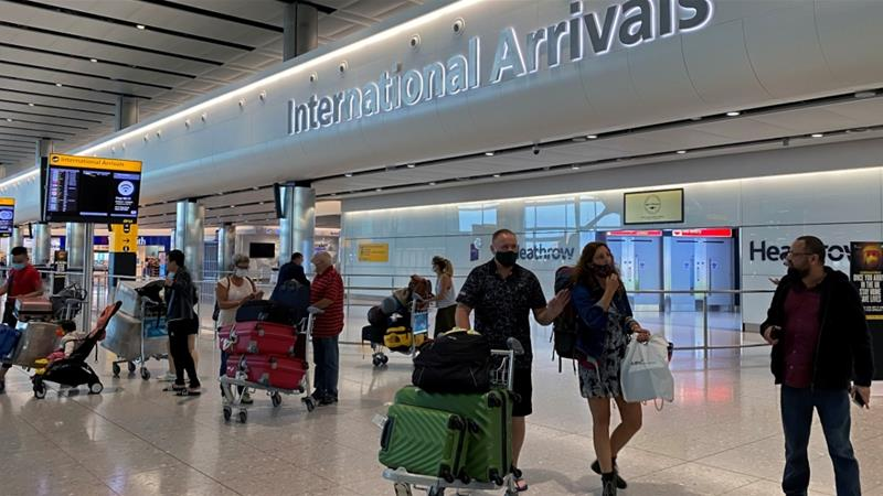 All international arrivals to the UK will be subject to a 14-day quarantine from June 8 [Toby Melville/Reuters]