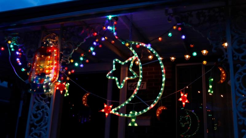 Ramadan lights decorate a house in Dearborn, Michigan to take part in a Ramadan lights competition in hopes of spreading joy and bringing back some of the holiday spirit during the coronavirus pandemic [Carlos Osorio/AP Photo]