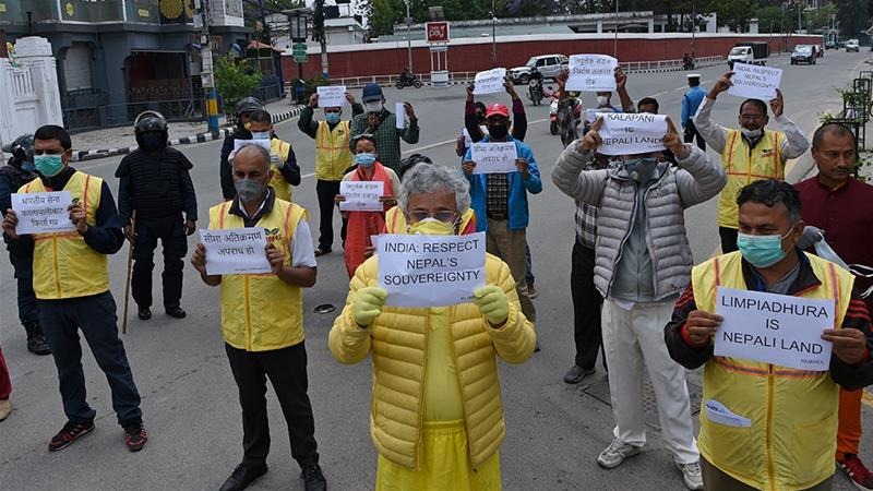 Activists protest against India's newly inaugurated link road to the Chinese border, near the Indian embassy in Kathmandu [File: Prakash Mathema/AFP]