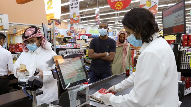 People wearing protective face masks and gloves shop at a supermarket during the coronavirus pandemic in Riyadh, Saudi Arabia, where wealthy investors throughout the Middle East region are being more cautious, according to Barclays [File: Ahmed Yosri/Reuters]