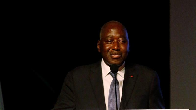 Ivorian prime minister, favoured to succeed president, dies at 61