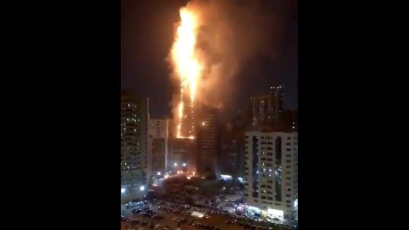 Videos on social media purportedly of the fire showed burning debris falling from a tower engulfed in flames [Screenshot]