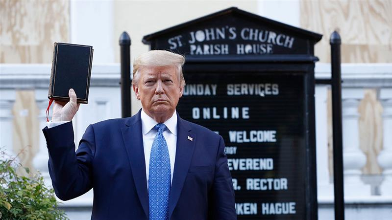 US President Donald Trump holds a Bible as he visits outside St John's Church across Lafayette Park from the White House on Monday, June 1, 2020, in Washington, DC. Part of the church was set on fire during protests on Sunday night [Patrick Semansky/AP Photo]