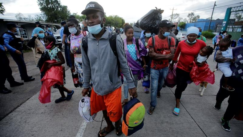 Migrants who are stranded in Honduras after borders were closed due to the pandemic are seen as they board a bus going to a shelter, in Tegucigalpa, Honduras on June 3, 2020 [Jorge Cabrera/Reuters]