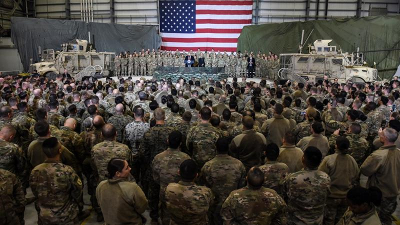 US President Donald Trump speaks to troops during a surprise Thanksgiving Day visit at Bagram Air Field in Afghanistan in 2019 [File: Olivier Douliery/AFP]