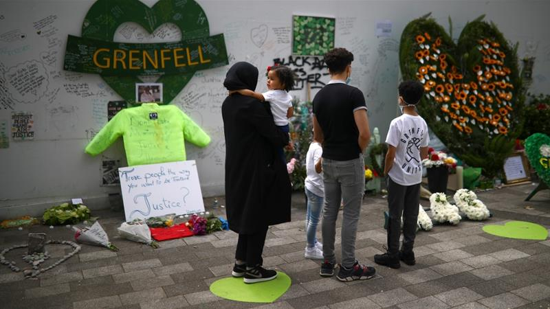People commemorate the third anniversary of the Grenfell Tower fire in London on June 14 [Reuters]