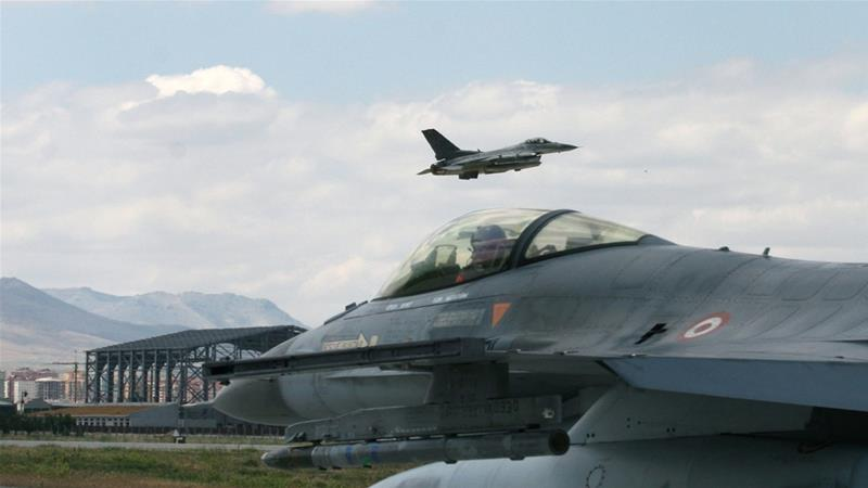 A Turkish F-16 prepares to taxi while another one takes off [File: Selcan Hacaoglu/AP Photo]