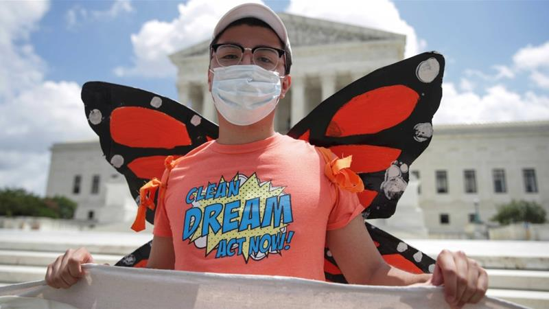 A DACA recipient celebrating outside the US Supreme Court last month in Washington, DC following a decision in their favour. US President Donald Trump said on Friday he would soon issue an executive order that includes a path to citizenship for DACA recipients [File: Jonathan Ernst/Reuters]