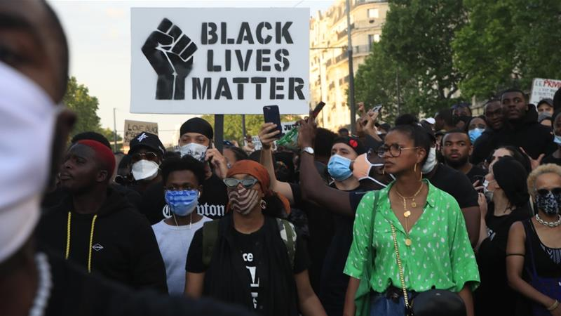 Fires & tear gasoline: Black Lives Matter march turns chaotic in Paris