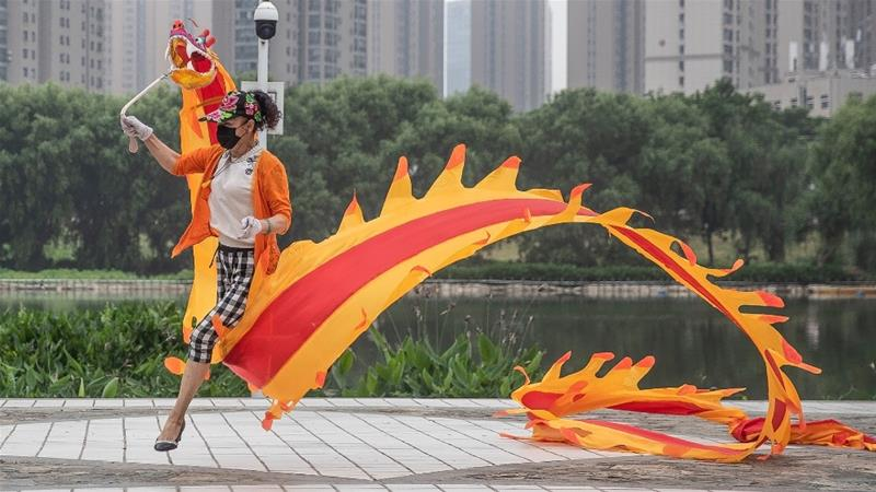 China has dismissed as 'ridiculous' a study suggesting coronavirus could have been circulating in Wuhan, where life is returning to normal, as early as August last year [Stringer/ AFP]