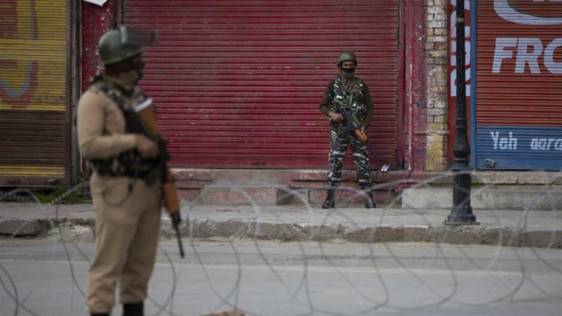 Indian paramilitary soldiers stand guard on a road in Srinagar, Indian controlled Kashmir on May 6, 2020 [AP/ Dar Yasin]