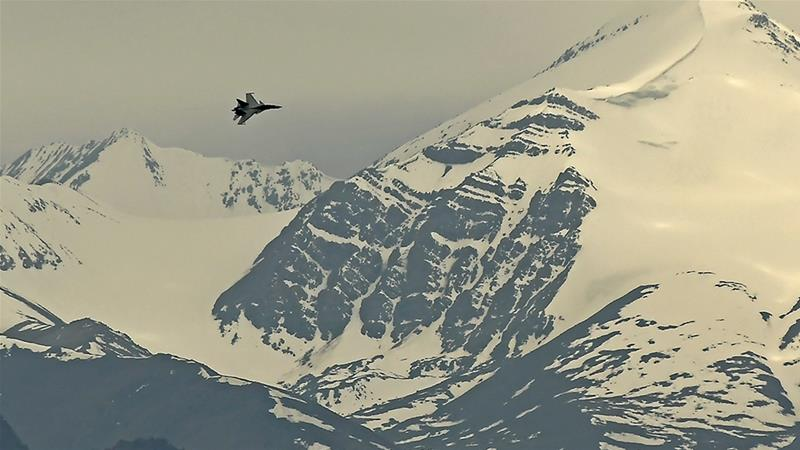 An Indian fighter jet flies over Leh in Ladakh region on Wednesday amid simmering border tensions with China [Tauseef Mustafa/AFP]