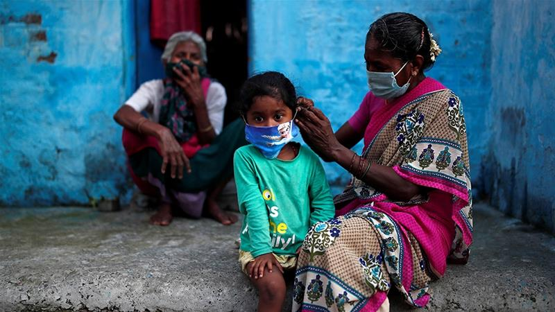 The pandemic has hit India's poor the hardest, from the disease itself to the economic and social impact of a recently lifted nationwide lockdown [Adnan Abidi/Reuters]