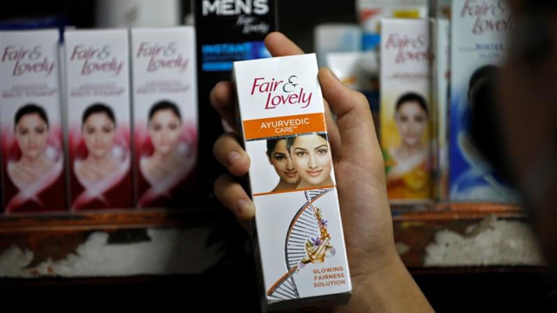 A customer picks up Fair & Lovely brand of skin lightening product from a shelf in a shop in Ahmedabad, India, which is the biggest market for the cream and where fairness products have long been endorsed by leading Bollywood celebrities [Amit Dave/Reuters]