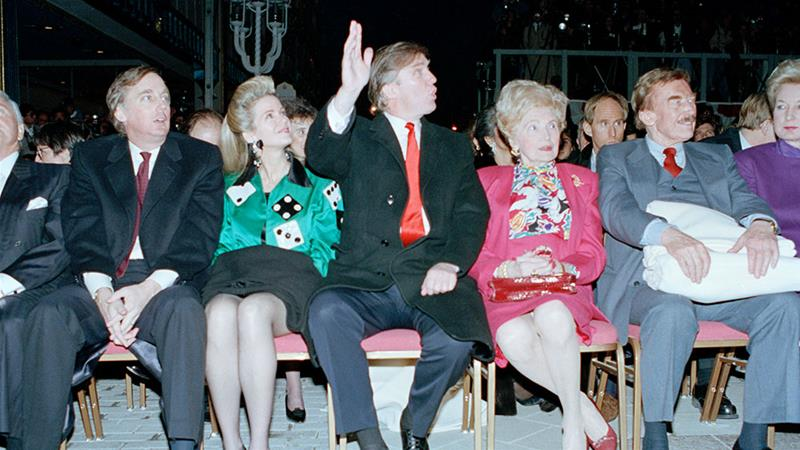 Donald Trump and family at the Trump Taj Mahal Casino Resort in Atlantic City, New Jersey in 1990. To the left of Trump is his older brother, Robert Trump, and his wife, Blaine Trump, whose daughter has written a book the family is attempting to quash [File: Charles Rex Arbogast/AP Photo]