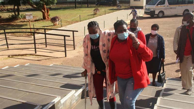 The three women are all leaders of the Movement for Democratic Change's youth section [Tsvangirayi Mukwazhi/AP Photo]
