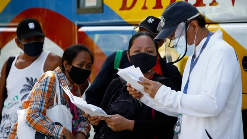 Despite the surge in infections in the Philippines, some cities including Metro Manila have lifted travel restrictions, raising fears of the virus spreading to other parts of the country [Rolex dela Pena/EPA]