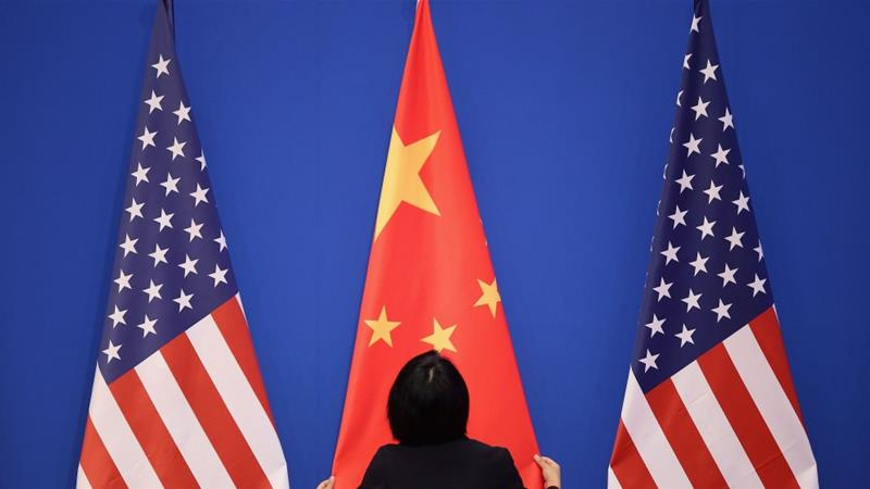 The US and China have moved to use regulations to attack one another on a wide and expanding range of industries including technology, energy and air travel [File: Feng Li/Getty Images via Bloomberg]