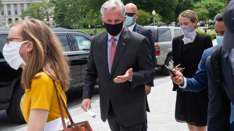 US House Minority Leader Kevin McCarthy, a Republican from California, wears a mask as he leaves following a press conference in Washington, DC, the United States [File: Saul Loeb, AFP]