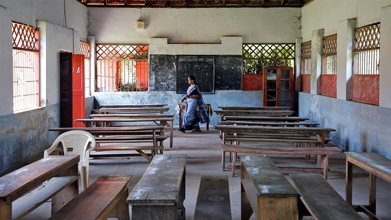 A staff member inside an empty classroom of a school in Kochi after Kerala ordered closure of schools due to coronavirus fears [File: Sivaram V/Reuters]