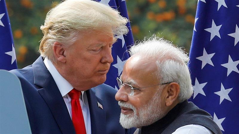 Trump and Modi embrace during a joint news conference after bilateral talks in February this year at Hyderabad House in New Delhi [Adnan Abidi/Reuters]