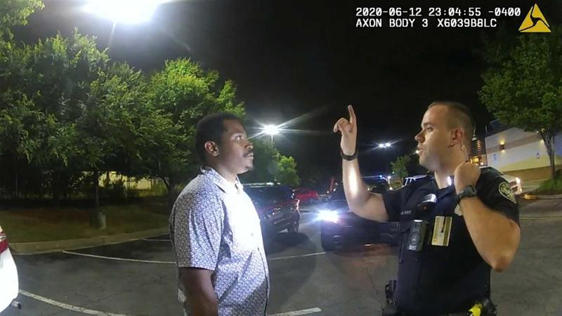 Former Atlanta Police Department officer Garrett Rolfe conducting a field sobriety test on 27-year-old Rayshard Brooks in a Wendy's restaurant car park in a still image from the video body camera of officer Devin Bronsan in Atlanta, Georgia [Atlanta Police Department/Handout via Reuters]