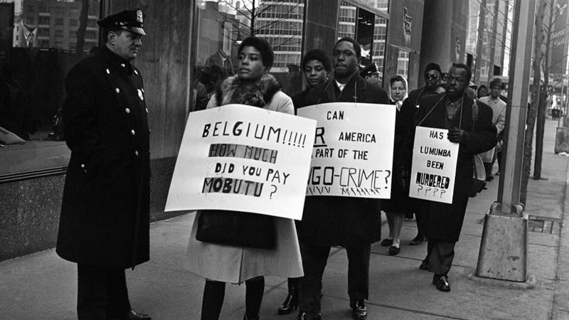 Pickets carrying anti-Belgian and pro-Lumumba placards parade near the Belgian consulate in New York, on February 11, 1961 [AP Photo/Jacob Harris]