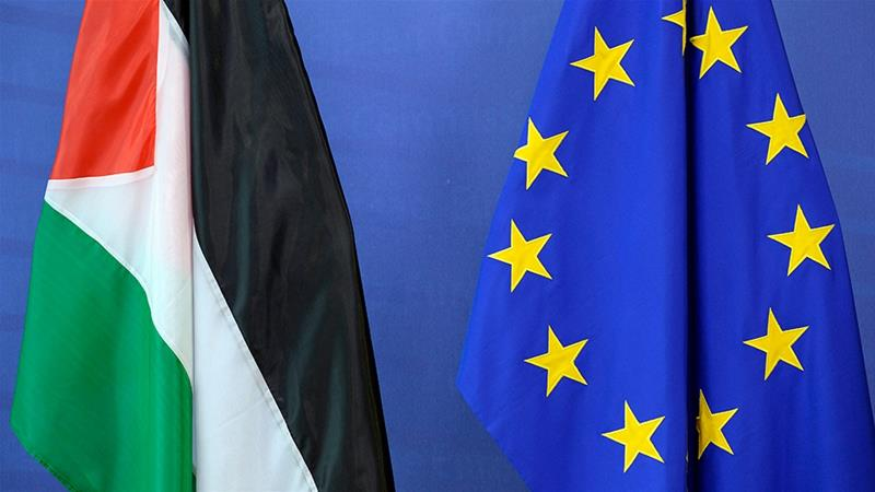 The Palestinian flag is seen next to the European Union flag at the European Union Commission headquarters in Brussels [File: Thierry Charlier/AFP]
