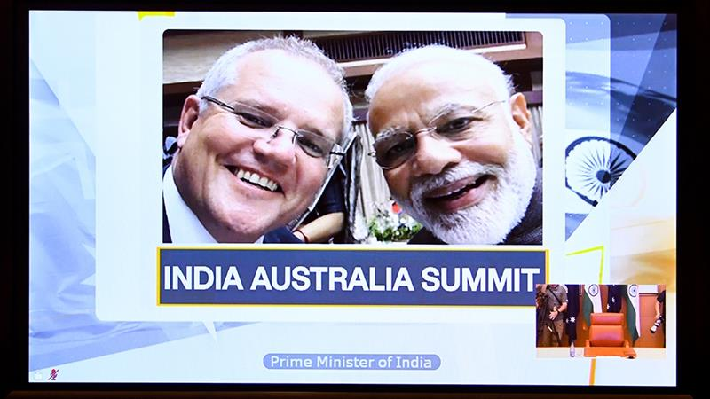 India and Australia sign deal to use each other's military bases ...