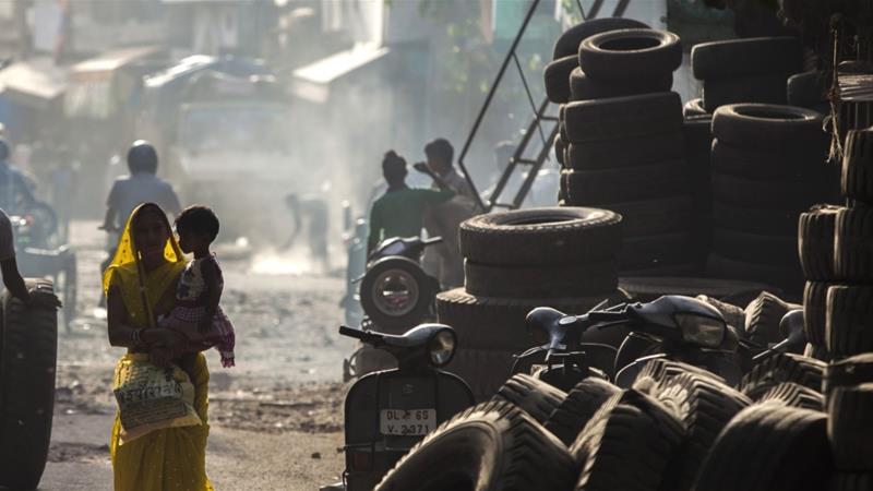 A woman and a child walk in New Delhi, India, where multiple campaigns have been launched to check child labour in recent years [File:  Prashanth Vishwanathan/Bloomberg]