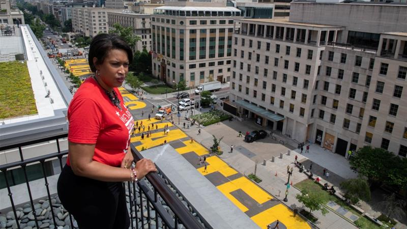 Mayor Muriel Bowser looks out over the Black Lives Matter street painting in Washington, DC as protests against George Floyd's death continue [Handout: Khalid Naji-Allah Executive Office of the Mayor via Reuters]