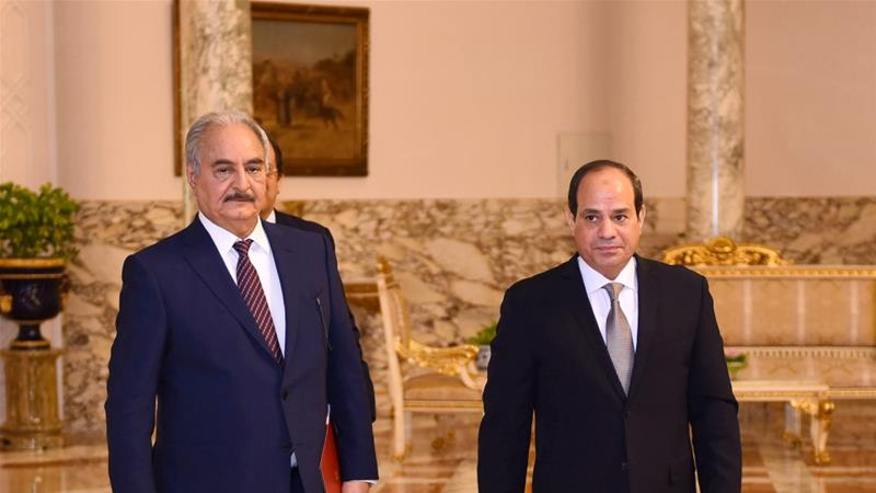 Libyan commander Khalifa Haftar walks with Egyptian President Abdel Fattah el-Sisi at the Presidential Palace in Cairo in April [Reuters]