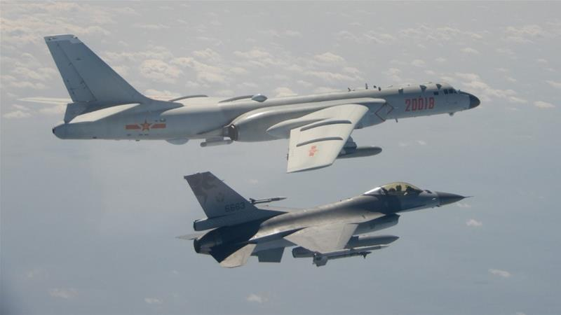 This handout photo taken and released on February 10, 2020 ws a Taiwanese F-16 fighter jet flying next to a Chinese H-6 bomber (top) in Taiwan's airspace [File: Handout/Taiwan's Defence Ministry/AFP]