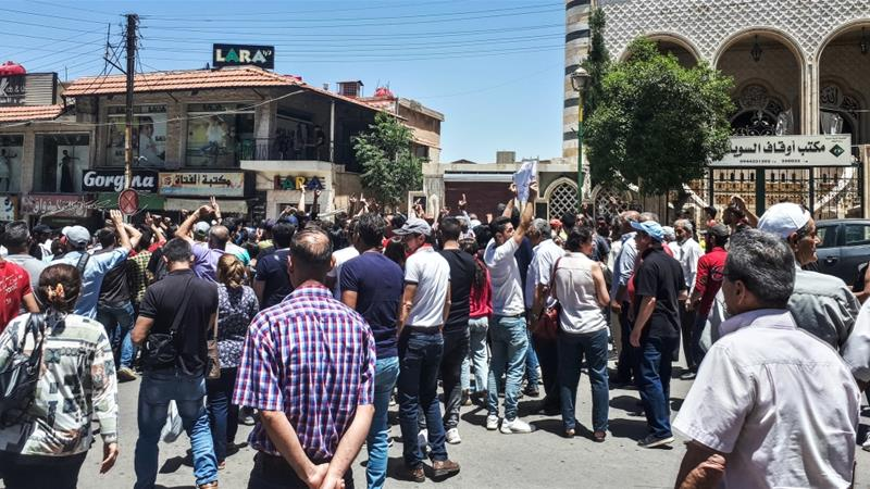 Syrians chant anti-government slogans as they protest the country's deteriorating economic conditions on June 9 [AFP]