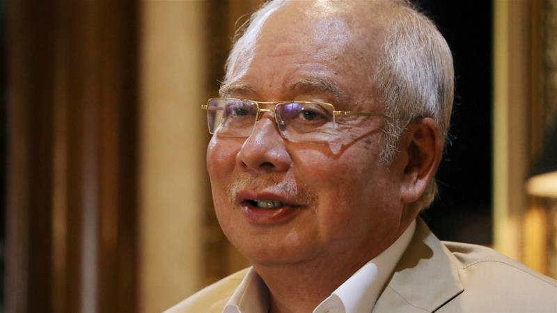Malaysia's former PM Razak faces multiple corruption charges in three separate trials linked to the siphoning off of billions from state fund 1MDB and other cases [File: Lim Huey Teng/Reuters]