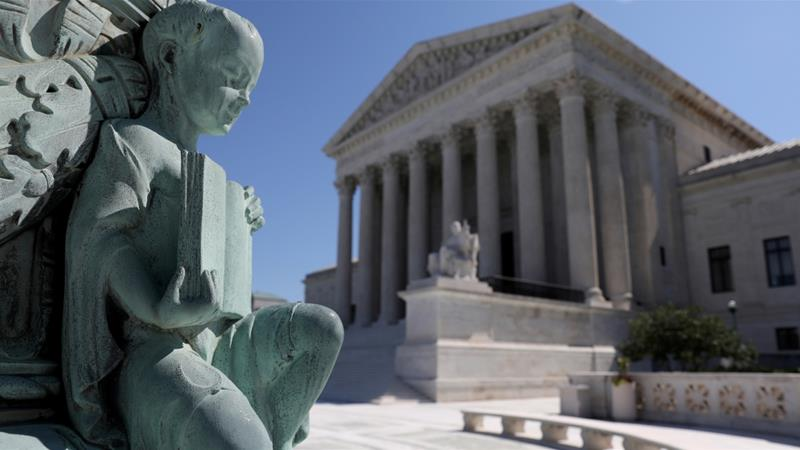 A cherub figure with a book, symbolising learning, is seen in a general view of the US Supreme Court building in Washington, US [File: Jonathan Ernst/Reuters]