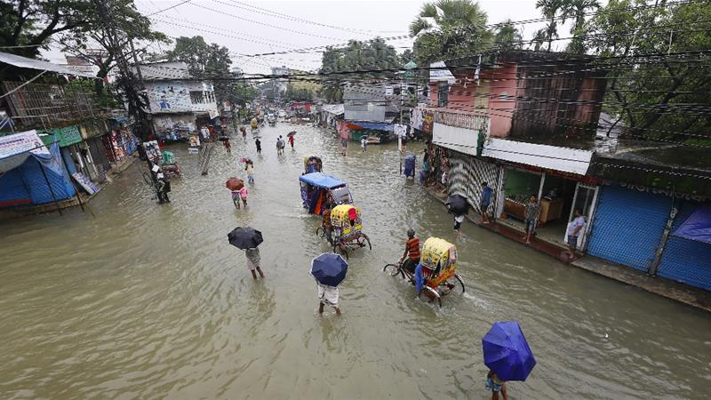 The floods started late last month, and after briefly easing continued to worsen, destroying crops and driving people from their homes in several impoverished regions [Sultan Mahmud/AFP]
