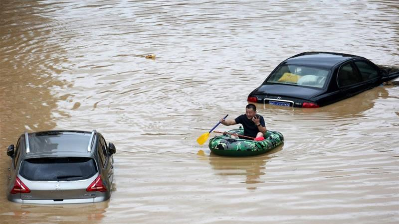 Grim': China battles record flooding after torrential downpours ...