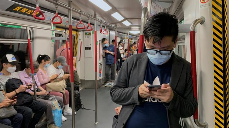 Masks will be mandatory for all passengers on public transport in Hong Kong under new rules that come into effect at midnight [Tyrone Siu/Reuters]