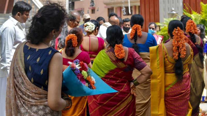 No more than 50 guests are allowed at India's famously lavish and colourful weddings to limit the risk of spreading coronavirus [File: Manjunath Kiran/AFP]