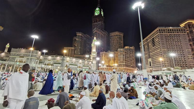 Muslims pray at the Grand Mosque during the annual Hajj pilgrimage in their holy city of Mecca. Only 1,000 people will be allowed to attend this year's event because of the coronavirus [File: Waleed Ali/Reuters]