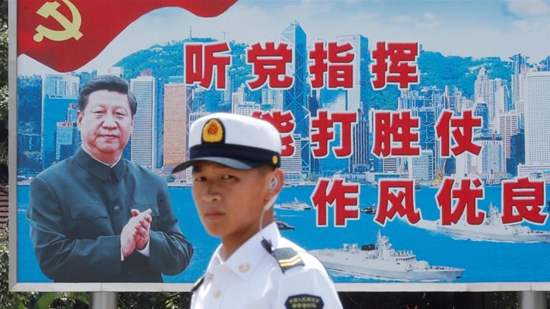 A Chinese Navy soldier stands guard outside China's Stonecutters Island naval base in Hong Kong [File: Tyrone Siu/Reuters]