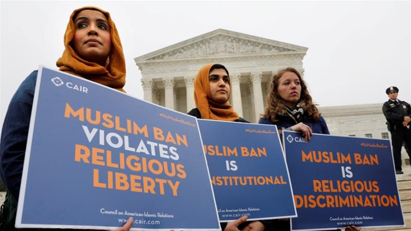 Trump's  initial ban targeted immigrants from Iran, Libya, Somalia, Syria and Yemen, triggering criticism that it amounted to unlawful religious discrimination [File:Yuri Gripas/Reuters]
