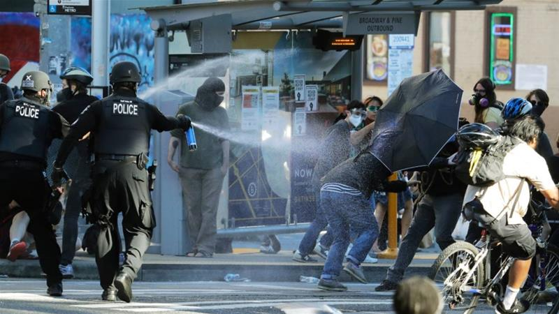 Police declare riot at Seattle protests, make arrests