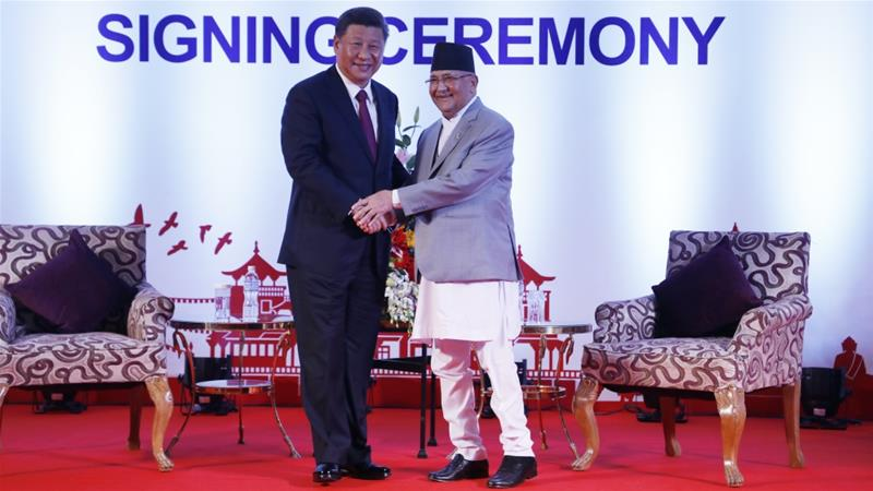 Chinese President Xi Jinping and Nepalese Prime Minister KP Sharma Oli greet during their bilateral meeting in Kathmandu, Nepal, Oct 13, 2019 [Bikash Dware/The Rising Nepal via AP]
